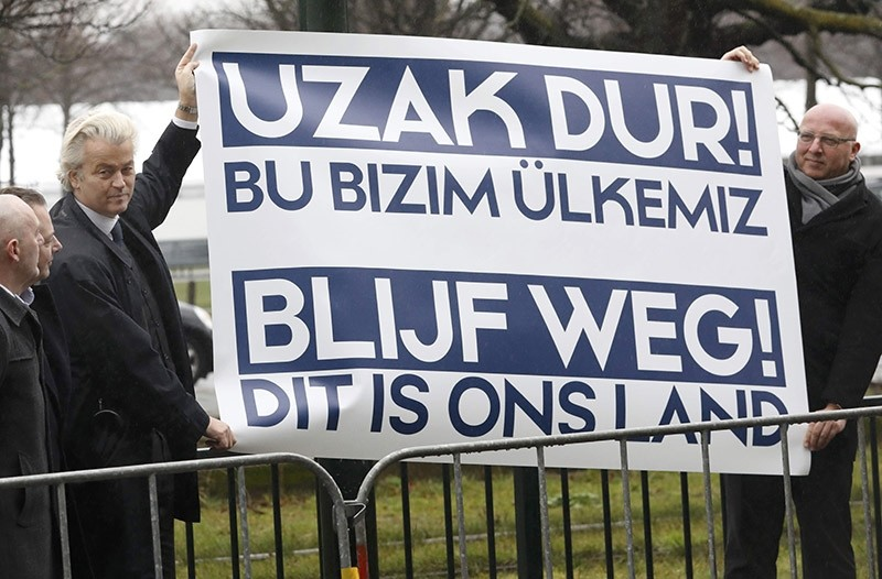 Dutch far-right politician Geert Wilders of the PVV party takes part in a protest outside the Turkish embassy in The Hague, Netherlands, March 8, 2017. Banner reads ,Stay away from our country. This is our land., (Reuters Photo)