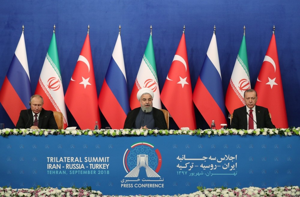 Iranian President Hassan Rouhani (C), President Recep Tayyip Erdou011fan (R) and Russian President Vladimir Putin (L) attend a press conference after their meeting in Tehran, Sept. 7.