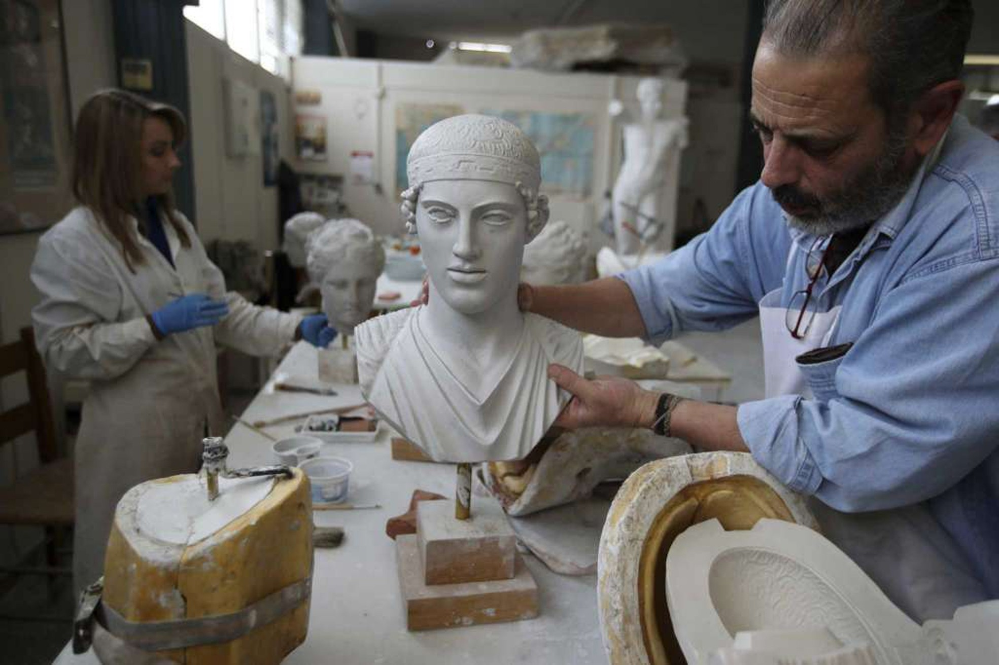 Artists working for the Athenu2019s Culture Ministry are emulating ancient works to sale them in Greek museum shops.