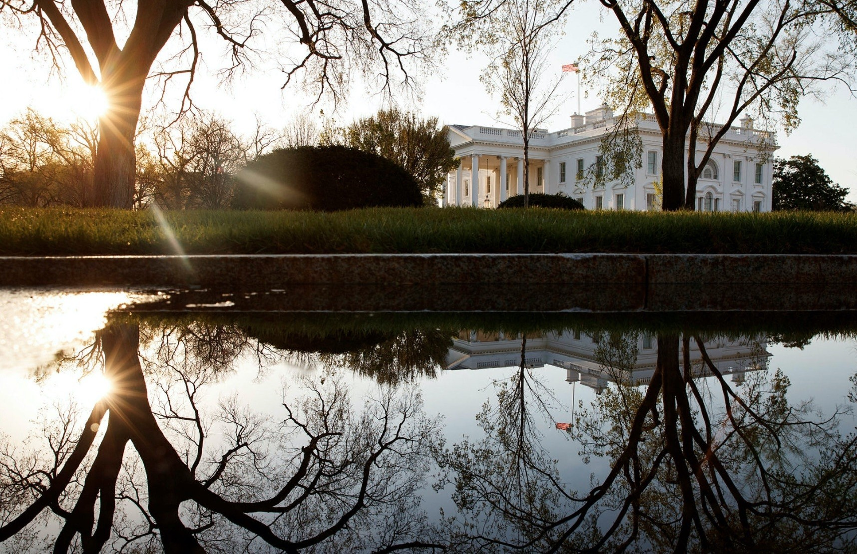 The White House is seen at sunrise in Washington, April 14, 2018.