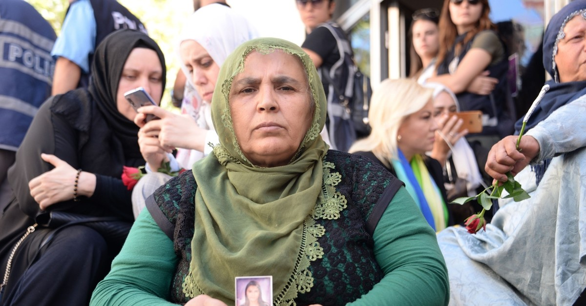 Kurdish mother Hu00fcsniye Kaya holds up a picture of her long-lost daughter 19-year-old Mekiye in front of the HDP headquarters in Diyarbaku0131r, Sept. 8, 2019.