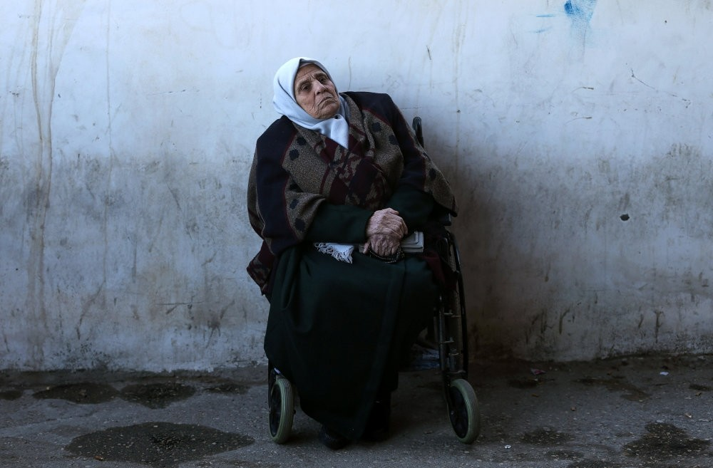 A wheelchair using Palestinian woman waits for a travel permit to leave Gaza through the Rafah border crossing with Egypt, Feb. 3, 2019.