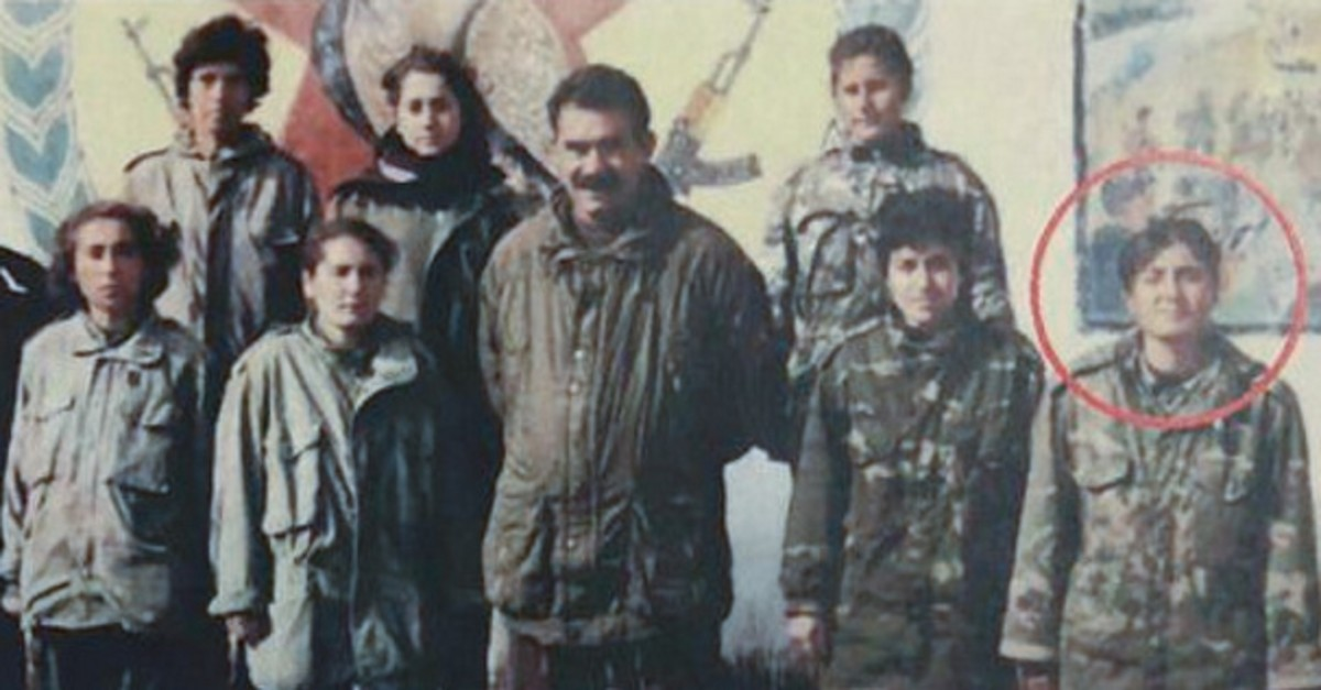 Terrorist Ayfer Kordu pictured with jailed PKK leader Abdullah u00d6calan and other terrorists in this undated photo (AA Photo)
