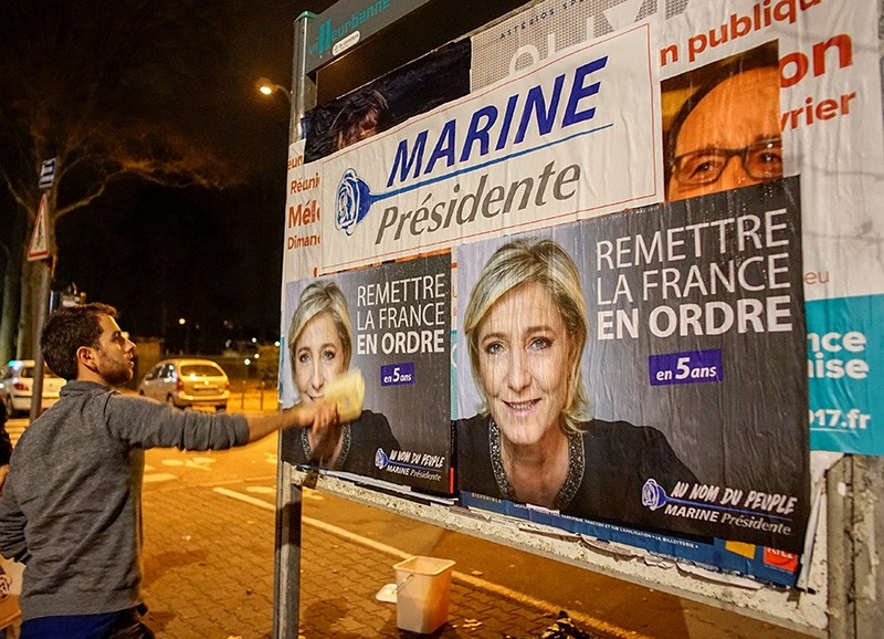 Members of the National Front youths put up posters of Marine Le Pen, ahead of a 2-day FN political rally to launch the presidential campaign in Lyon, France, February 2, 2017. (Reuters Photo)