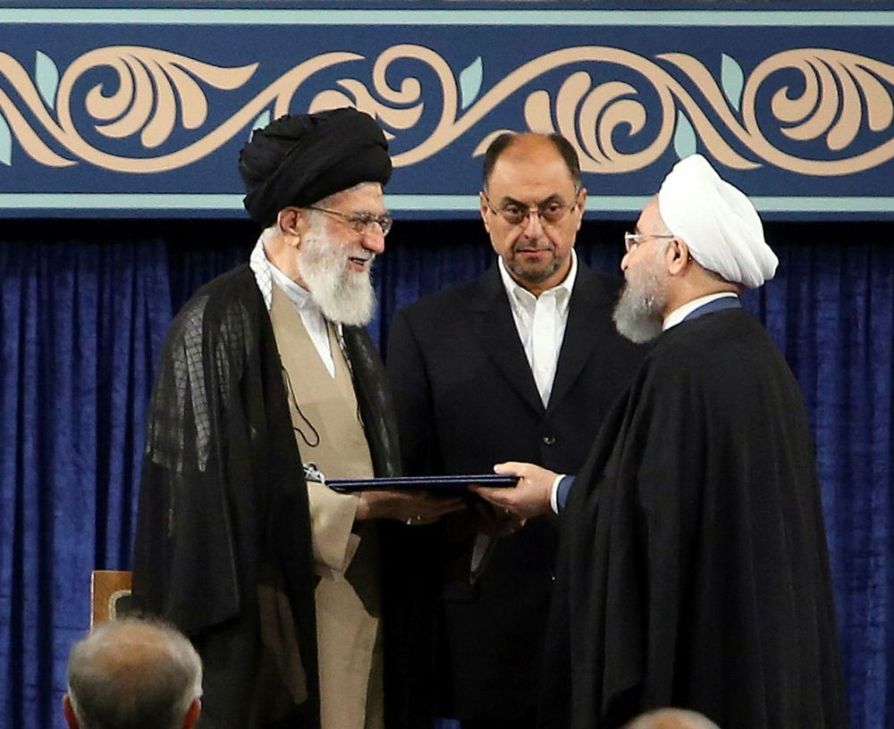 Iranian President Hassan Rouhani (R) receives the presidential mandate from Supreme Leader Ayatollah Ali Khamenei (L) during an endorsement ceremony, in Tehran, Aug. 3.