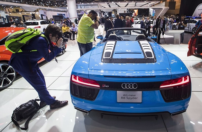People photograph the Audi R8 Spyder during the Canadian International Auto Show in Toronto, Thursday, Feb. 16, 2017. (AP Photo)