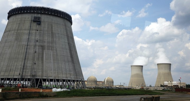 A new cooling tower for a nuclear power plant reactor that's under construction stands near the two operating reactors at Plant Vogtle power plant in Waynesboro, Ga., operated by Westinghouse Electric Co., U.S. nuclear unit of Japan's Toshiba Corp.