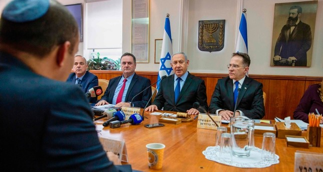 Israeli Prime Minister Benjamin Netanyahu chairs the weekly cabinet meeting at his office in Jerusalem on November 24, 2019. AFP Photo