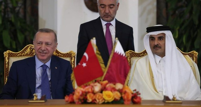 President Recep Tayyip Erdoğan (L) and Qatari Emir Sheikh Tamim bin Hamad Al Thani during the agreement signing ceremony in Doha, Qatar, Nov. 25, 2019. (AA Photo)