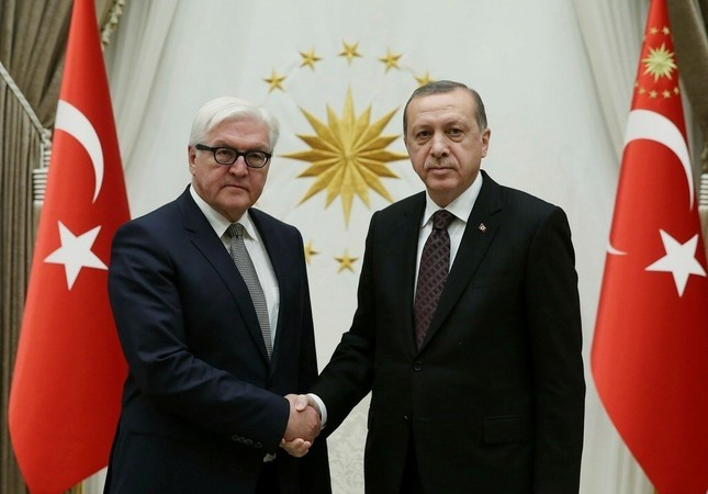 Then-German FM Steinmeier (L) and President Erdou011fan shake hands in the Presidential Complex, 11 November 2016. (AA Photo)