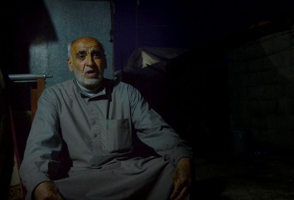 Muhammad Sellum, former school director of Tel Rifaat, speaks to Anadolu Agency at Sucu refugee camp in Syria's Azaz.