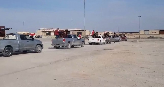 A convoy of Assad regime forces entering Afrin in northern Syria where Turkish military lauched an operation. (Source: Syrian State TV)