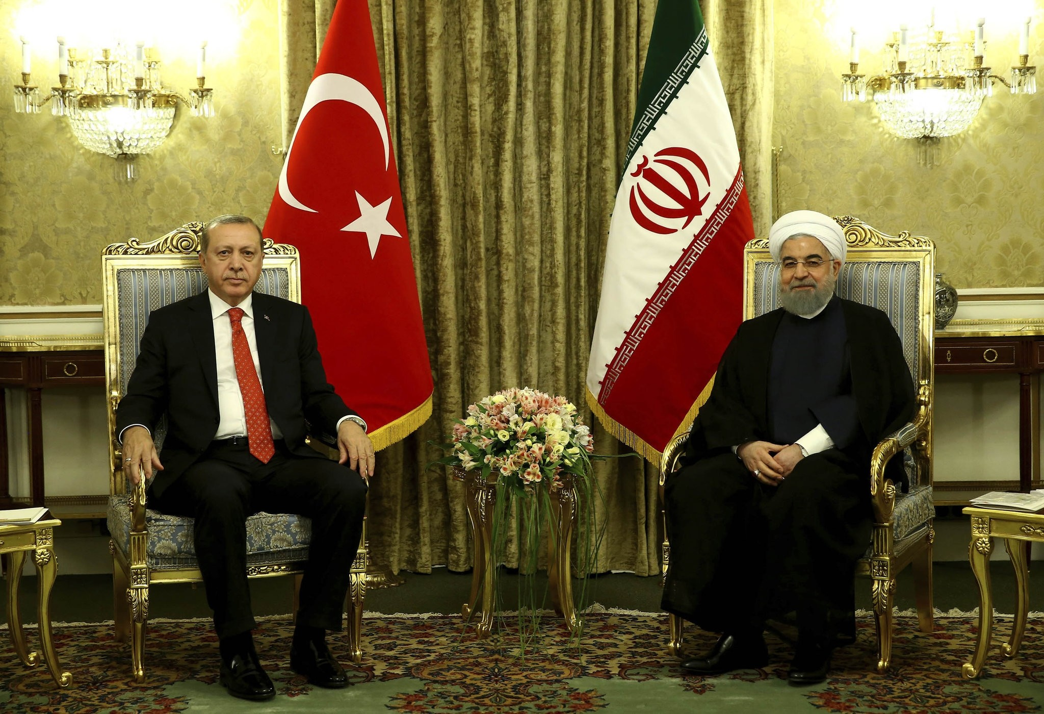President Erdou011fan (L) meets with Iranian President Rouhani at the Saadabad Palace in Tehran, Iran, Oct. 4.
