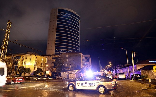 A police car stands in front of the Leogrand hotel at the Black Sea city of Batumi, Georgia, Nov. 25, 2017. (EPA Photo)