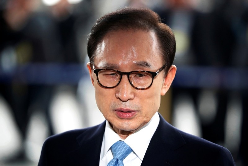 In this March 14, 2018, file photo, former South Korean President Lee Myung-bak arrives for questioning over bribery allegations at the Seoul Central District Prosecutors' Office in Seoul, South Korea. (AP Photo)