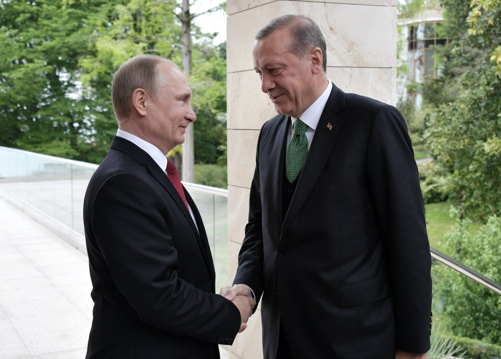 Russian President Vladimir Putin shakes hands with Turkish President Recep Tayyip Erdou011fan during their meeting at the Bocharov Ruchei residence in the Black sea resort of Sochi, Russia, May 3.