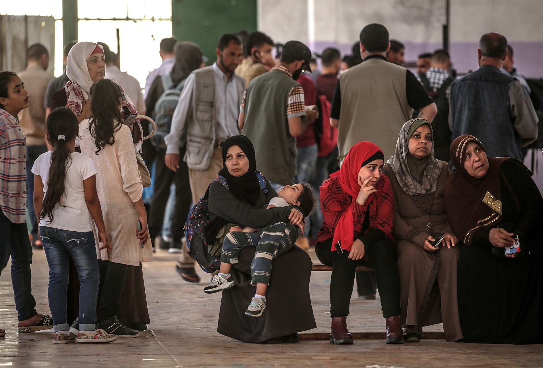 Besieged Palestinians wait to cross Rafah border with Egypt in order to access health care and basic goods, Gaza Strip, May 25.