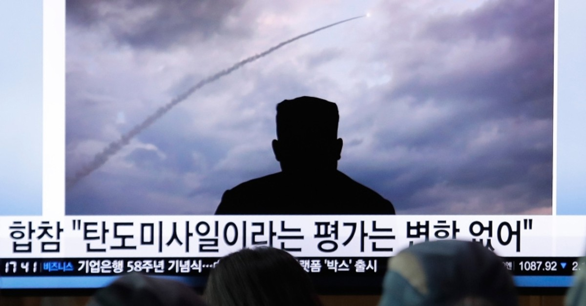 In this Thursday, Aug. 1, 2019, file photo, people watch a TV showing an image of North Korea's a multiple rocket launch during a news program at the Seoul Railway Station in Seoul, South Korea. (AP Photo)