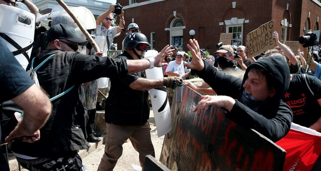 White nationalists, neo-Nazis and members of the 'alt-right' clash with counter-protesters as they enter Lee Park during the 'Unite the Right' rally Aug.12 in Charlottesville, Virginia.