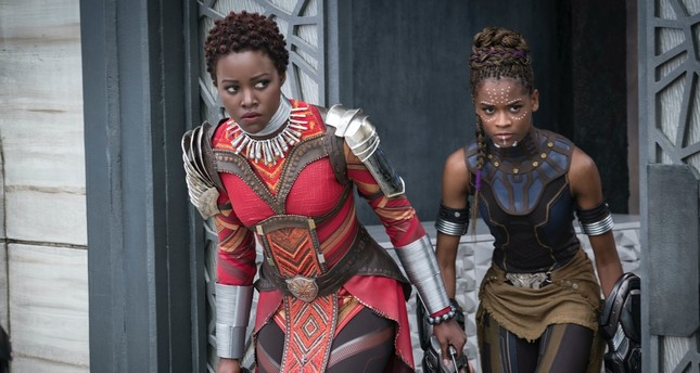 "Lupita Nyong'o, left, and Letitia Wright in a scene from ""Black Panther."""