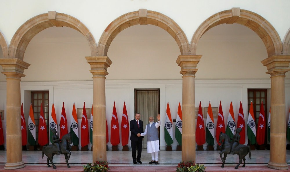 President Recep Tayyip Erdou011fan (L) shaking hands with India's Prime Minister Narendra Modi during a photo opportunity ahead of their meeting at Hyderabad House in New Delhi, India, Monday.