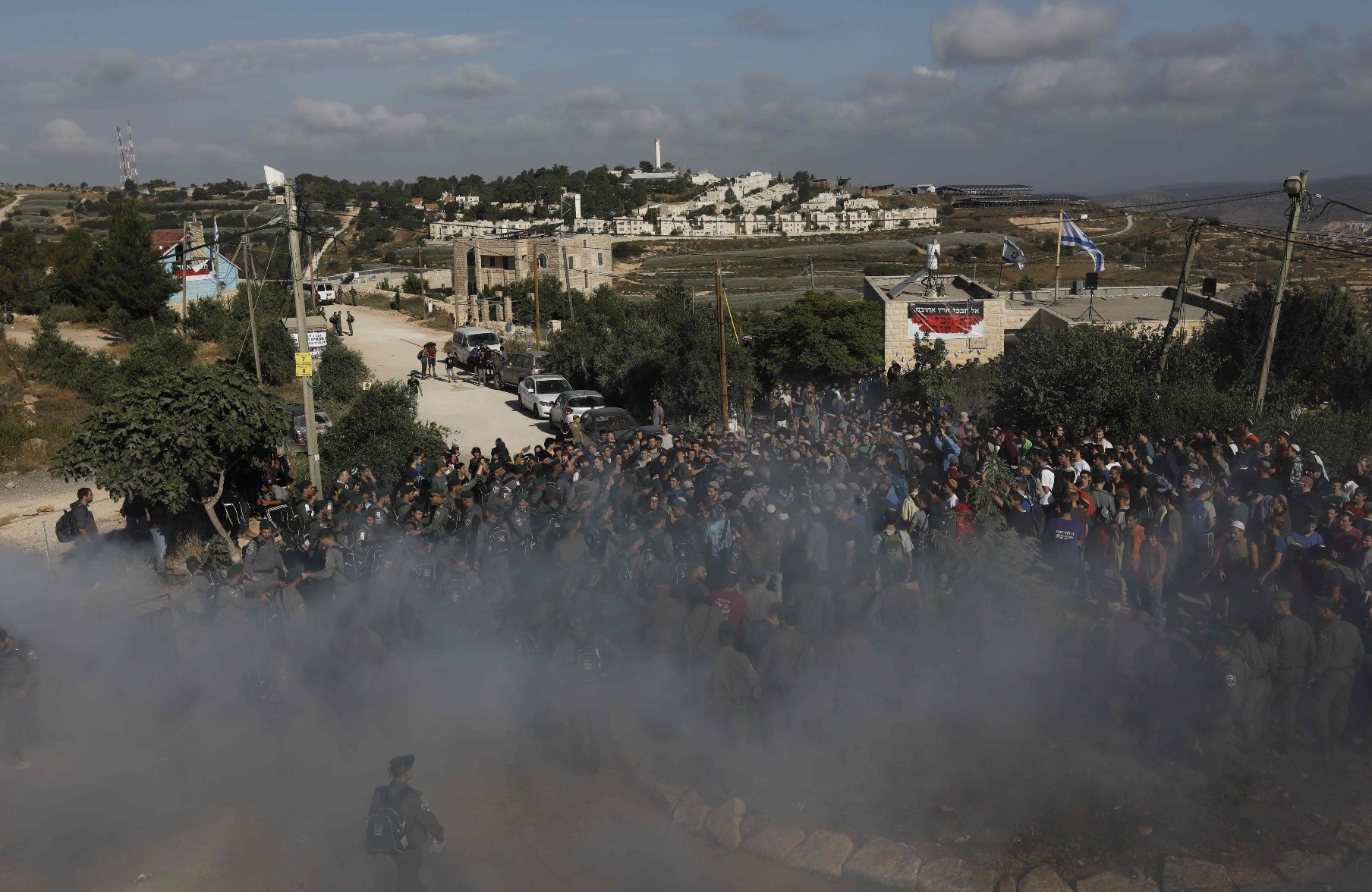 Israeli settlers scuffle with Israeli security forces at Netiv Hau2019avot settlement near Bethlehem in the occupied West Bank, June 12.