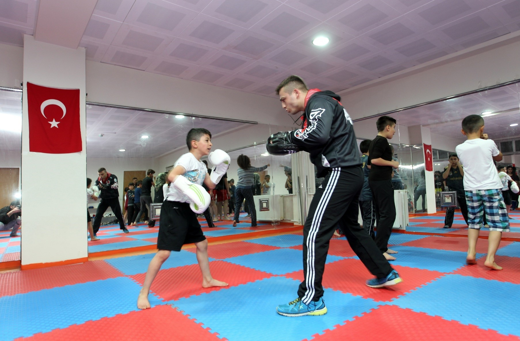 u00dcnal Au015fu0131k teaches a student Muay Thai. He is one of four officers devoting their days off to children in the city of Hakkari.