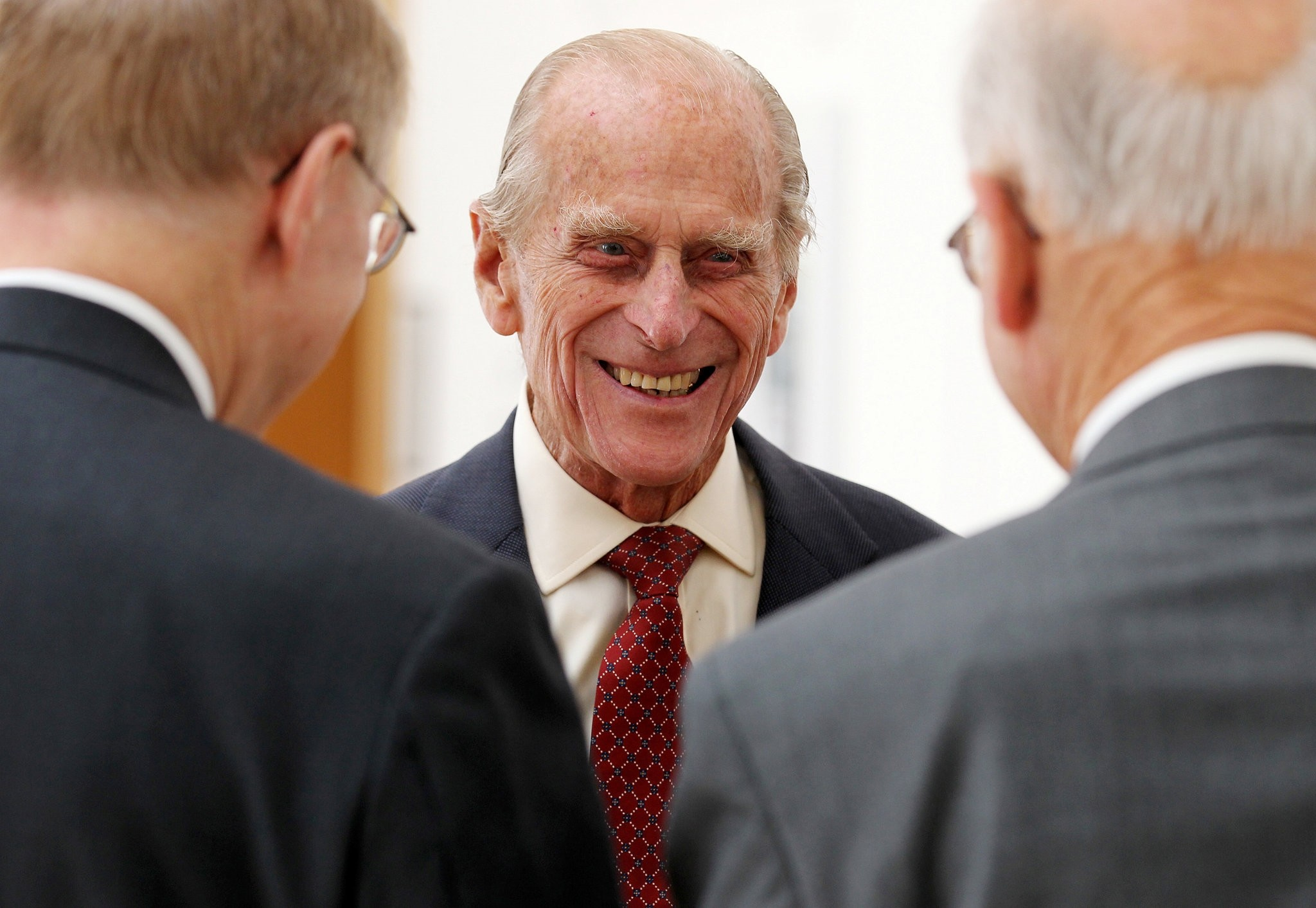 Prince Philip (C) smiles after presenting Royal Medals at the Royal Society of Edinburgh, in Edinburgh August 12, 2013. (REUTERS Photo)