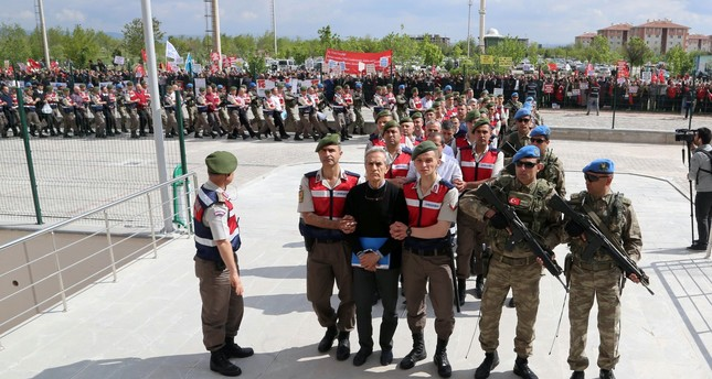 Turkish Gendarmerie escort defendants Akin Öztürk (3L) and others involved in July 15, 2016's attempted coup as they leave the prison where they are being held, ahead of their trial in Ankara in 2017.
