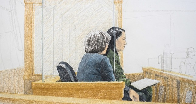In this courtroom sketch, Meng Wanzhou, right, the chief financial officer of Huawei Technologies, sits beside a translator during a bail hearing at British Columbia Supreme Court in Vancouver, on Friday, Dec.  7, 2018. (The Canadian Press via AP)