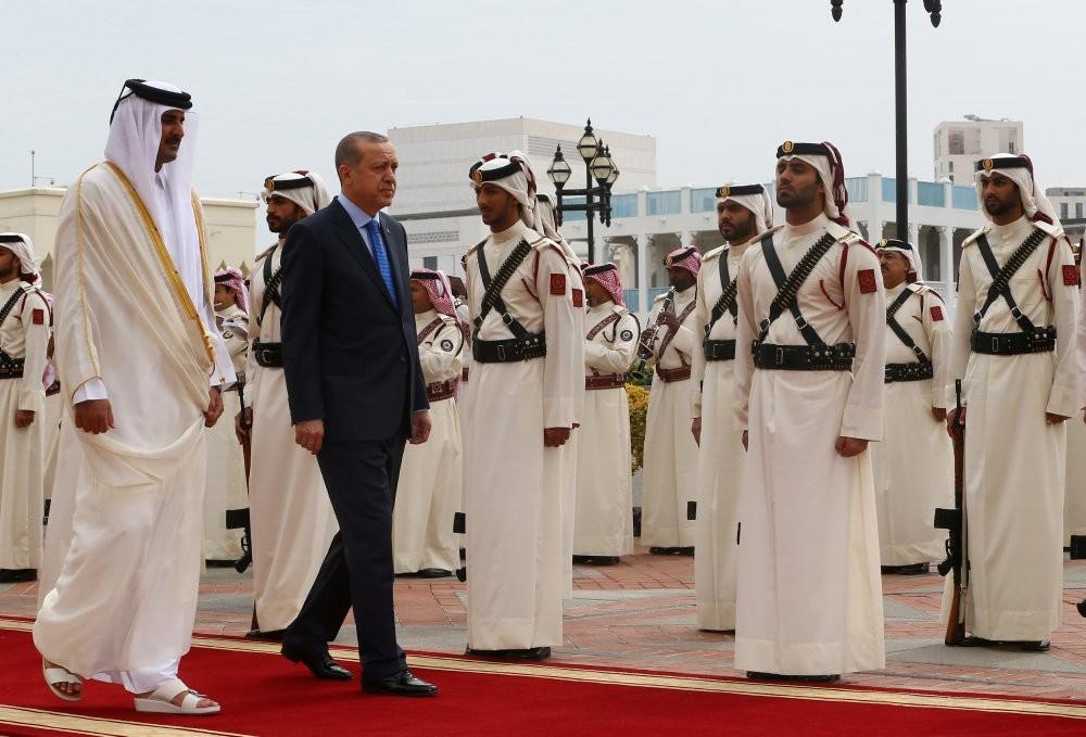 Turkish President Recep Tayyip Erdou011fan is seen with Emir of Qatar Sheikh Tamim bin Hamad Al-Thani during a welcoming ceremony in Doha, Qatar, Feb. 15, 2017.