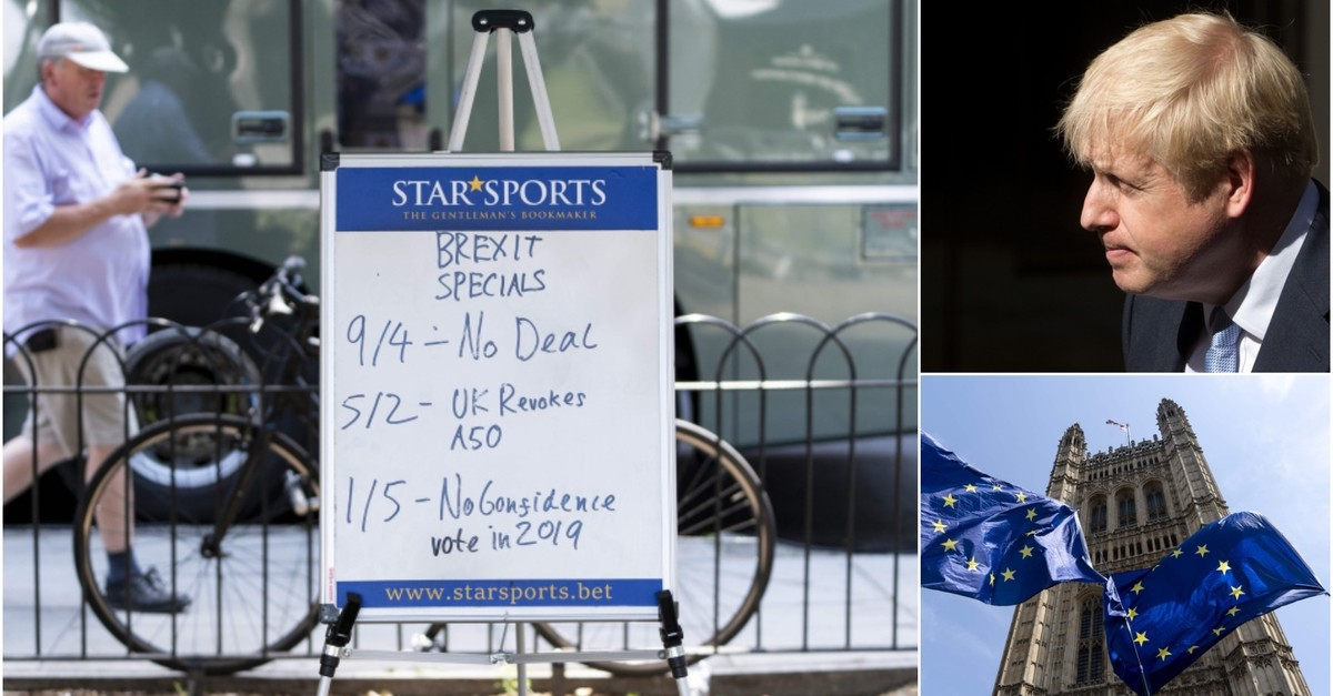 A man walks past a placard proclaiming odds on Brexit on the day of Britain's newly elected prime minister Boris Johnson's (T-R) debut in the House of Commons, outside the Houses of Parliament (B-R) in central London on July 25, 2019. (AFP Photos)