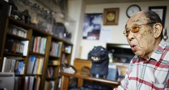 In this April 28, 2014 photo, original Godzilla suit actor Haruo Nakajima, who has played his role as the monster, speaks during an interview at his home in Sagamihara, near Tokyo. (AP Photo)