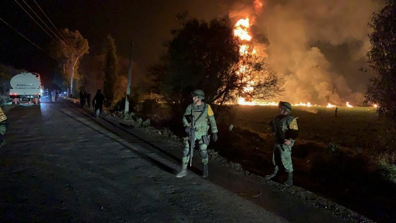 In this image provided by the Secretary of National Defense, soldiers guard in the area near an oil pipeline explosion in Tlahuelilpan, Hidalgo state, Mexico, Friday, Jan. 18, 2019 (AP Photo)