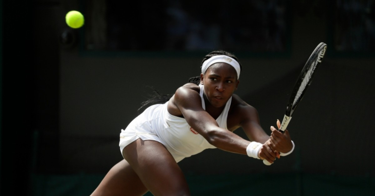United States' Cori ,Coco, Gauff returns the ball to Romania's Simona Halep in a women's singles match during day seven of the Wimbledon Tennis Championships in London, Monday, July 8, 2019. (AP Photo)