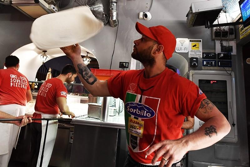 Neapolitan pizza makers prepare pizzas in a bottega in Naples, Italy, Dec. 6, 2017. (AFP Photo)