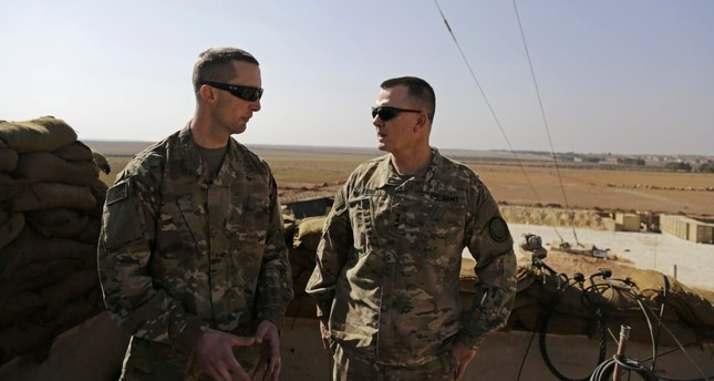 Two members of the U.S. Army at an American outpost in Manbij as part of Washington's support of PKK-linked Syrian nonstate groups, Syria, Feb. 7.