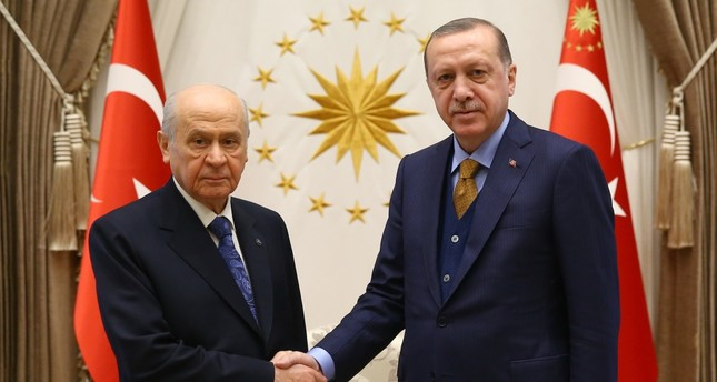 President Erdoğan shakes hand with MHP Chairman Devlet Bahçeli ahead of their 35-minute meeting at the Beştepe Presidential Complex in Ankara yesterday.