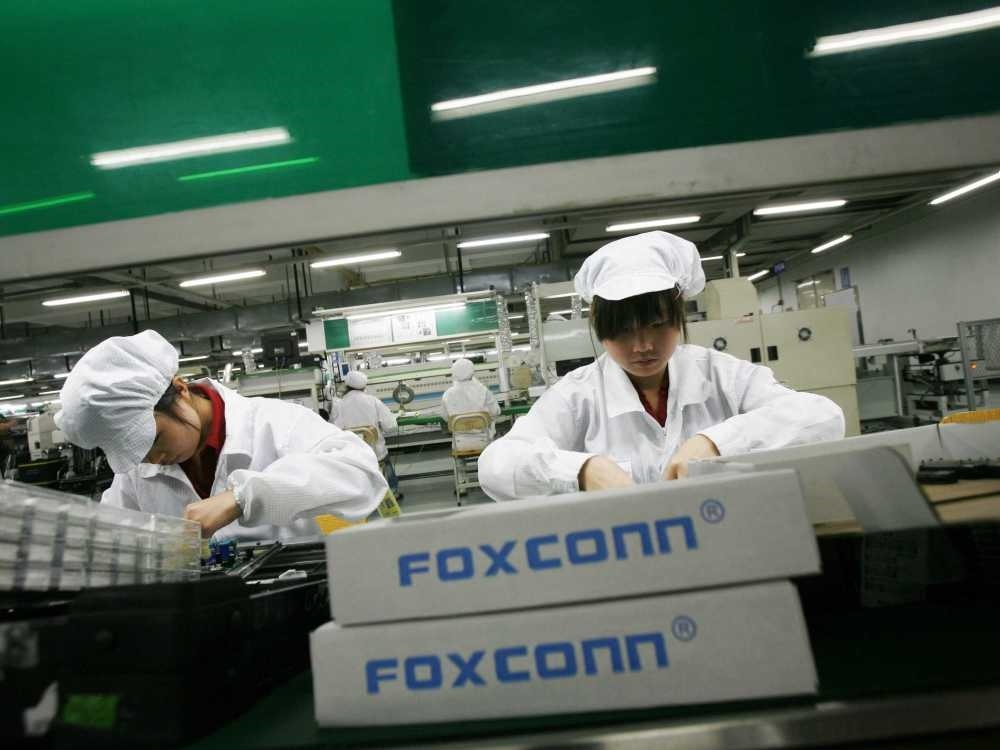 Workers on the production line at the Foxconn complex in the southern Chinese city of Shenzhen. The company manufactures Apple's iPhones.
