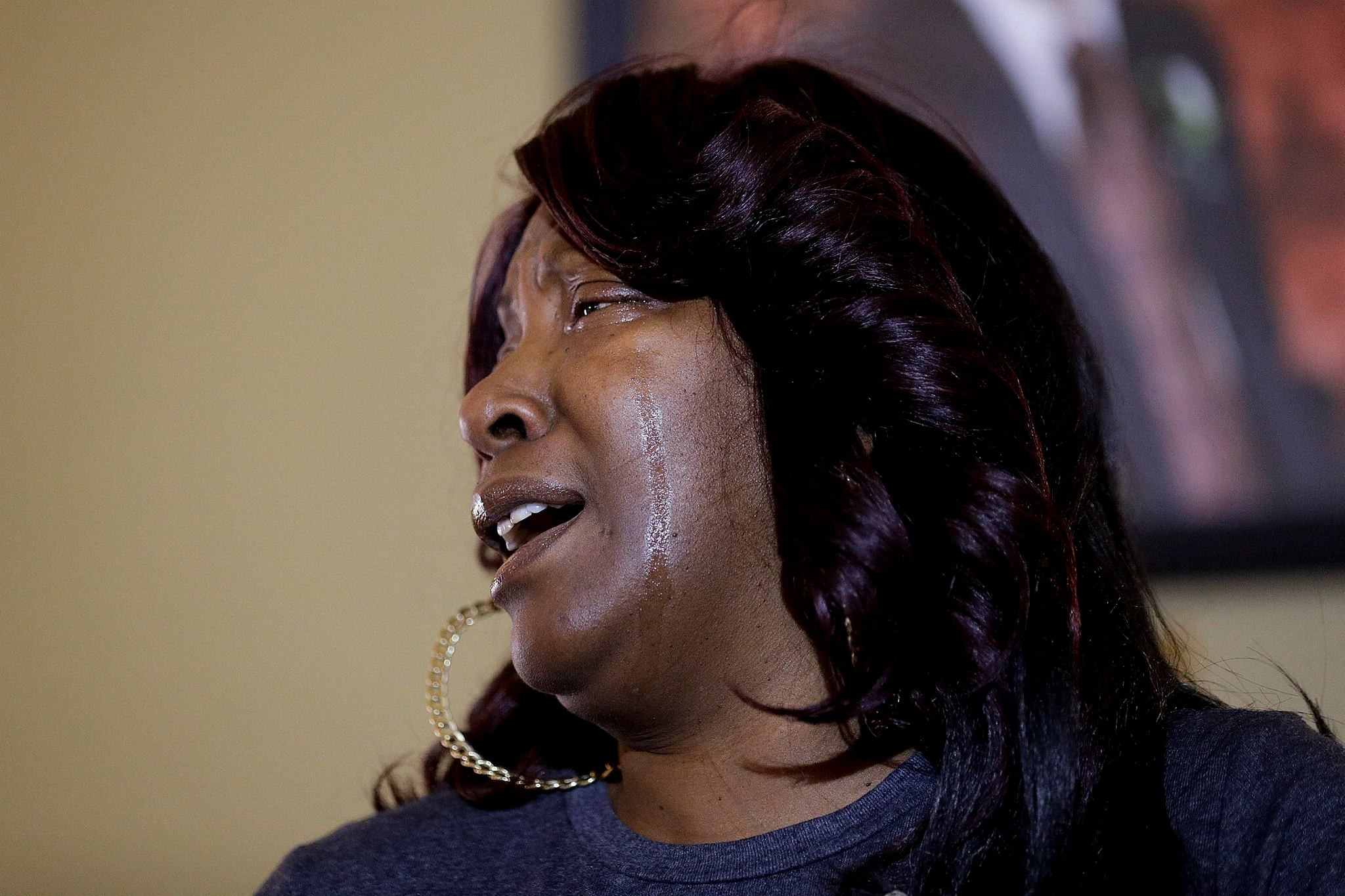 Ezell Ford's mother, Tritobia Ford, sheds tears while speaking at a news conference Tuesday, Jan. 24, 2017, in Los Angeles. (AP Photo)