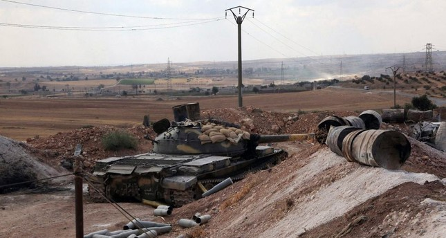 Assad's army tank was seen on Sept. 4 at a location on the southern outskirts of the Syrian city of Aleppo after Syrian regime forces retook control of three military academies from the opposition.