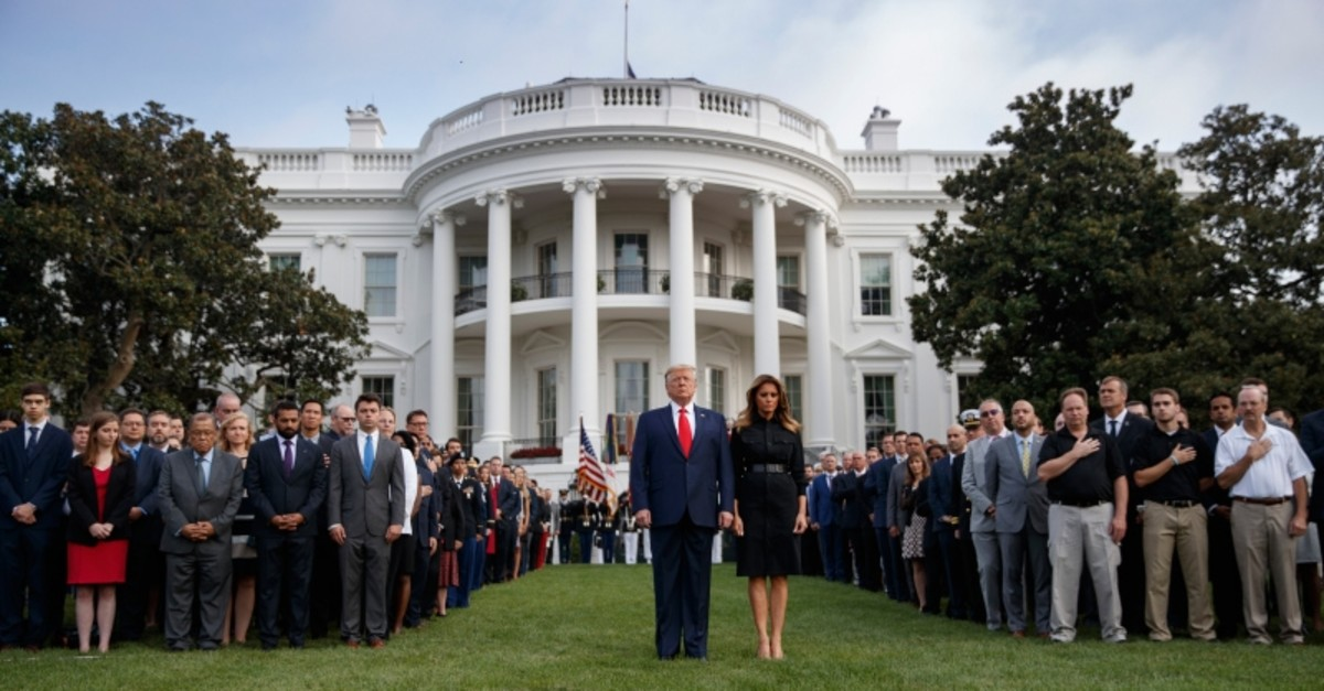 US President Donald J. Trump (L) and First Lady Melania Trump observe a moment of silence on the 18th anniversary of the 9/11 terrorist attacks at the White House in Washington, D.C. (EPA Photo)