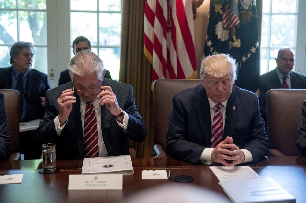 President Trump, accompanied by Secretary of State Tillerson, participates in a Cabinet meeting in the Cabinet Room of the White House in Washington, June 12.
