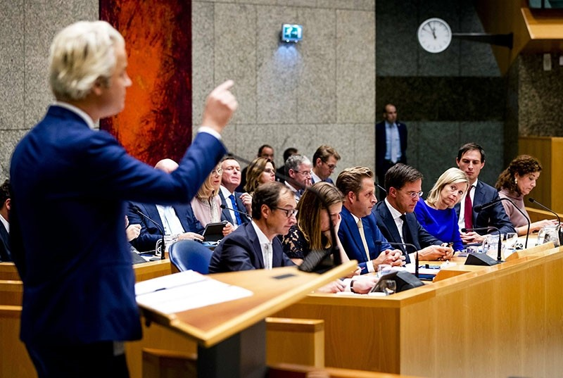 Party for Freedom (PVV) leader Geert Wilders (L) speaks as Dutch Prime Minister Mark Rutte (C) listens during a two-day debate in the Senate in The Hague, The Netherlands, Nov. 01, 2017. (EPA Photo)