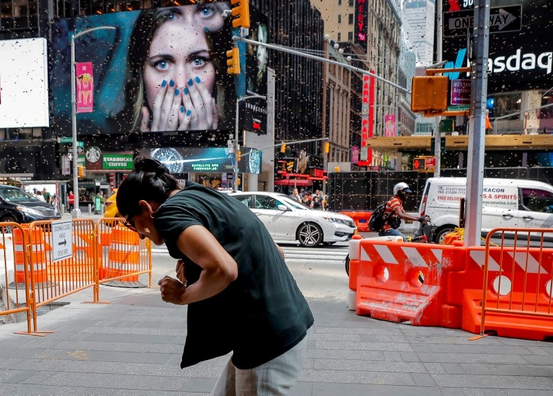A woman reacts to a swarm of bees in Times Square in New York City, U.S., August 28, 2018. (Reuters Photo)