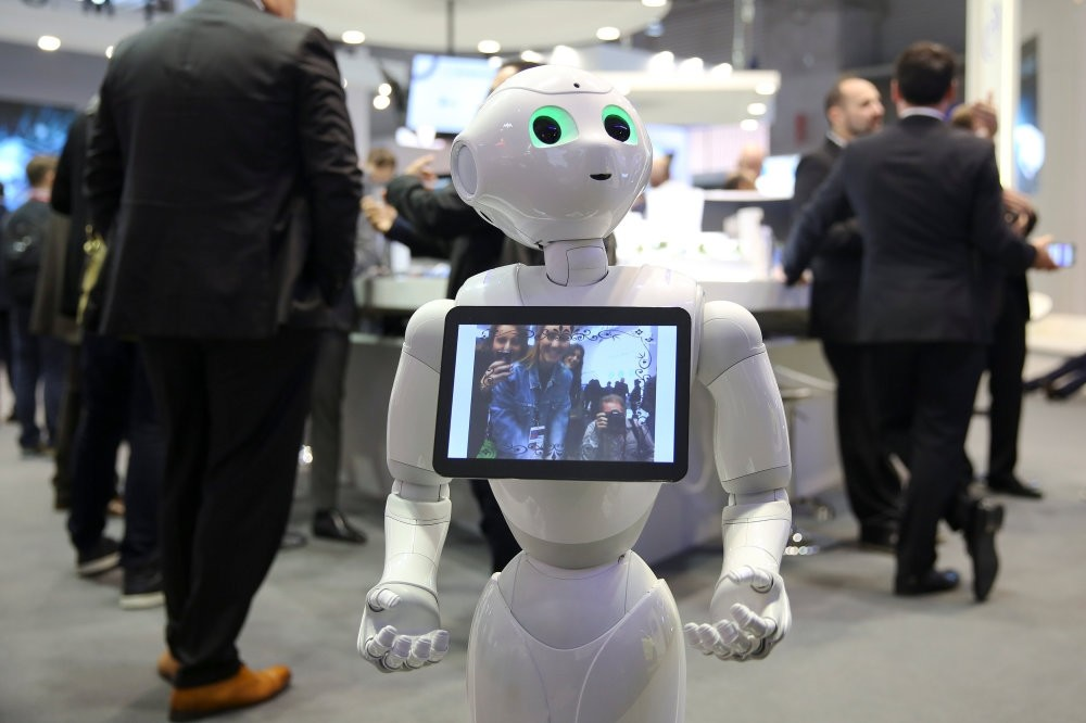 A robot displays a photograph it took of attendees at the Oberthur Technologies stand at the Mobile World Congress in Barcelona.