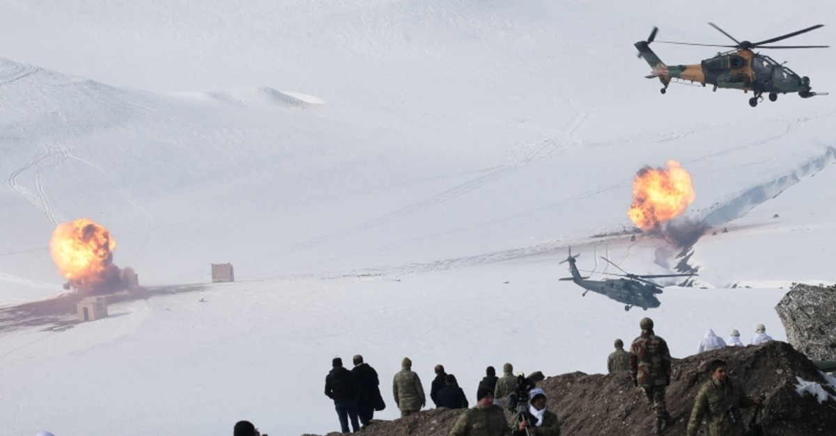 Turkish army helicopters fire on mock enemy positions during army's annual Winter-2019 exercises in a mountainous area near Kars, eastern Turkey, Thursday, Feb. 21, 2019. (Reuters Photo)