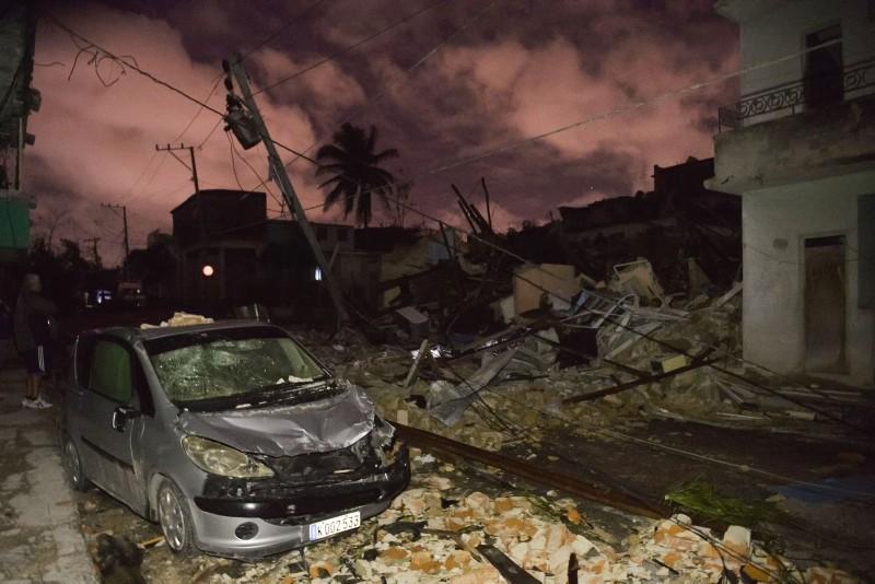 A damaged car is seen among building rubble in the tornado-hit Luyano neighborhood in Havana early on January 28, 2019. (AFP Photo)