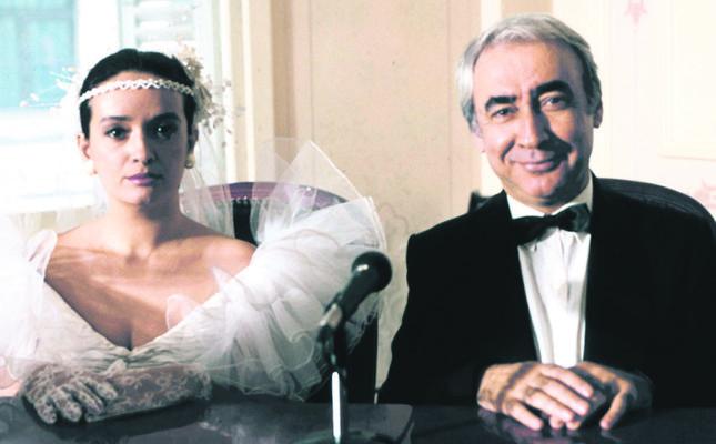 "Müjde Ar and Şener Şen in cult Türkish film ""Arabesque."""