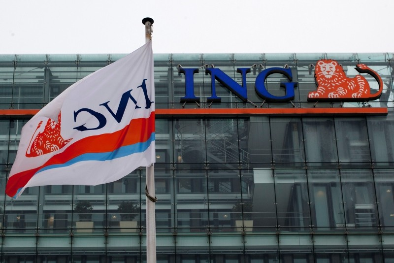 In this Thursday, Feb. 9, 2012 filer, a branded flag wave outside the ING head office in Amsterdam, The Netherlands. (AP Photo)